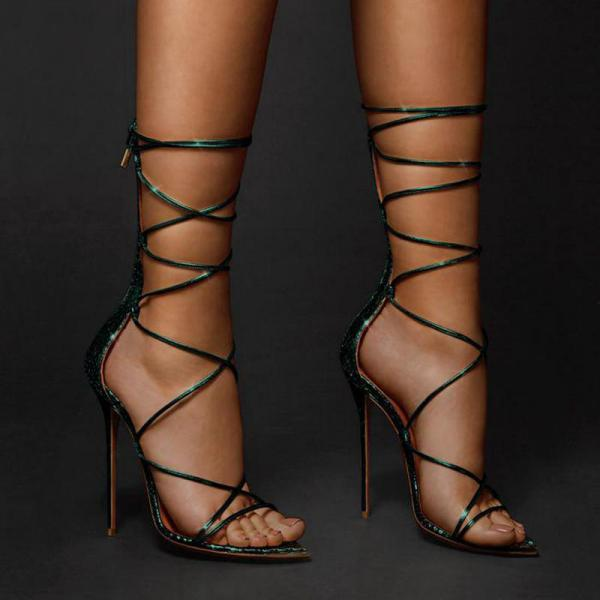 Pointed Roman cross strapped boots with thin heels